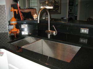 Faucet, sink and Josh\'s Baby the disposal button
